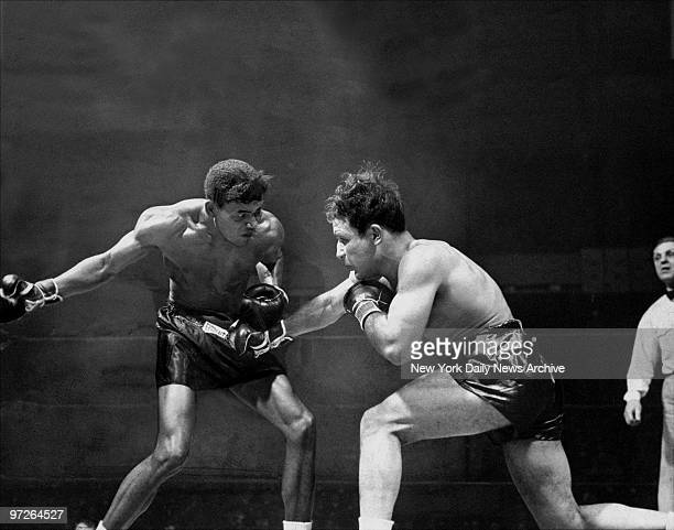 In second round at the Garden Sugar Ray Robinson winds up with a mighty haymaker to throw at Jake Lamotta Ray won the tenrounder unanimously