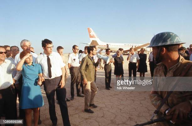 In September 1970 PFLP gunmen hijacked 3 passenger jet airliners and diverted them to Dawson Field, remote desert airfield near Amman Jordan, where...