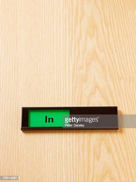 'In' sign on door, close-up