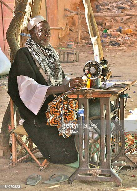 In small towns around Mali one can see men working hard at their sewing machines, usually outdoors to provide better lighting for their work....