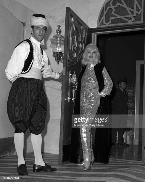 In something sleek and shimmering Hope Hampton puts even the fancilydressed El Morocco Night Club doorman in the shade as she arrives for last...