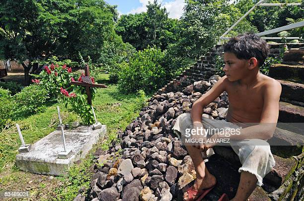 STORY in Spanish BY JULIA RIOS A child observes the headstone of the common grave on October 27 in the Casita Vulcano National Park 150 km northwest...
