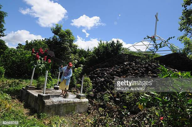 STORY in Spanish BY JULIA RIOS A woman sweeps the headstone of the common grave on October 27 in the Casita Vulcano National Park 150 km northwest of...