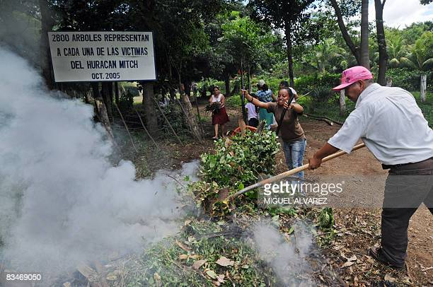 STORY in Spanish BY JULIA RIOS Locals clean on October 27 2008 the Memorial Monument next to a common grave where the victims of a landslide of the...