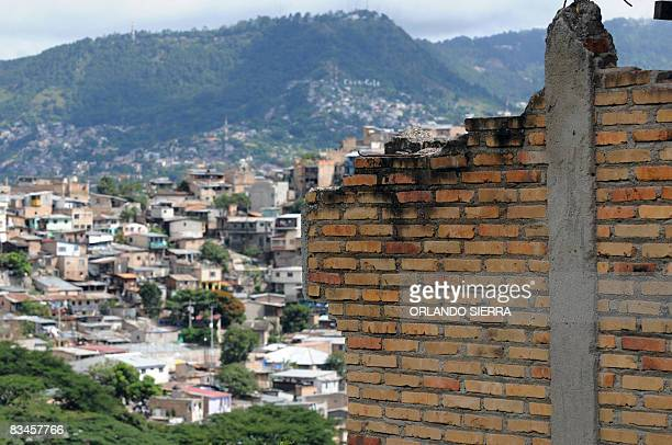 STORY in Spanish by Noe Leiva A wall of the house that belonged to Honduran builder Pedro Funez as was destroyed 10 years ago by Hurricane Mitch...