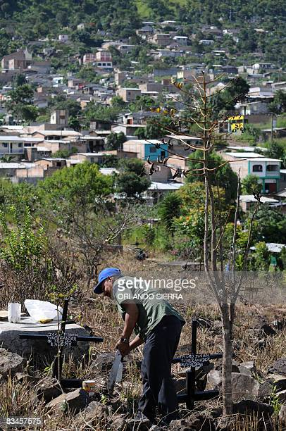 STORY in Spanish by Noe Leiva Honduran builder Pedro Funez visits the graves of his family at the cemetery for the poor Divino Paraiso in a suburb of...