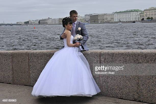 In St. Petersburg, many newly-weds come to the river side of Neva River to take commemorative photos with their families and well-wishers in deluxe...