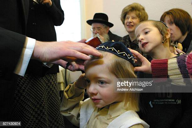 In Stamford Hill, London, United Kingdom, on the 3rd birthday of a Orthodox Jewish boy he has his first ever hair cut leaving his peyos to grow. His...