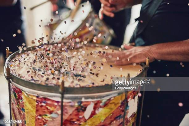 in sync to brazilian beats - carnival stock photos and pictures