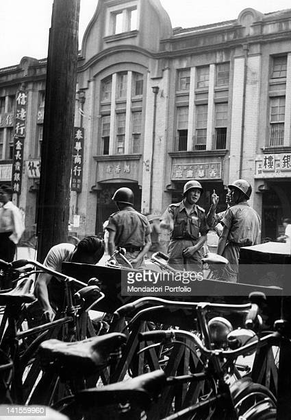 In Taipei Chung Road a patrol of Nationalist soldiers overseeing a home Taipei 1950s