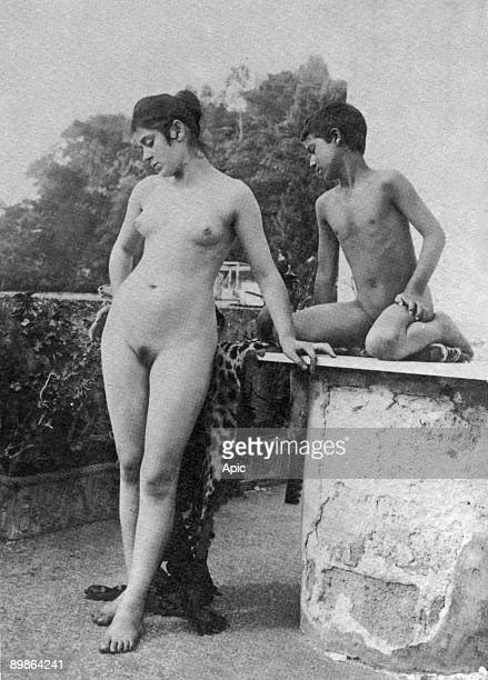 In Taormina Sicily naked young woman and boy photo by german gay photograph Wilhelm von Gloeden c 1900