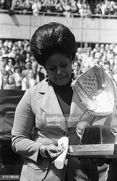 In tears Mrs Vera Clemente widow of Roberto Clemente Pirate player who died in an air crash 12/31/72 accepts the 1972 Gold Glove Award for fielding...
