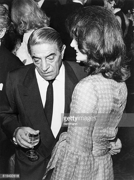 In Tehran for a four day visit shipping magnate Aristotle Onassis chats with his wife Jacqueline Kennedy Onassis at a party given in his honor