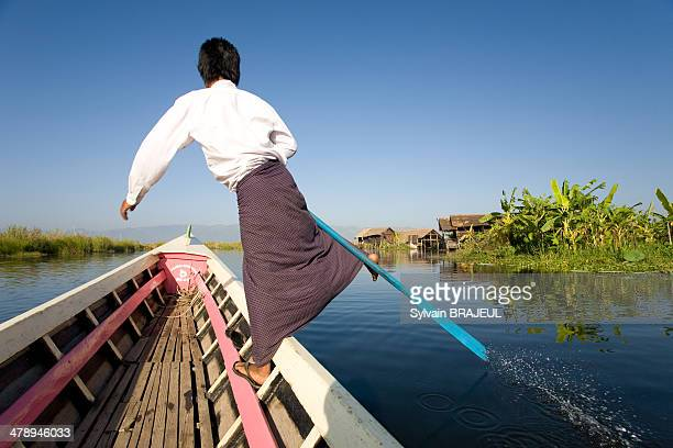 CONTENT] In Tha rower on a boat in the Inle Lake Shan State Burma or Myanmar