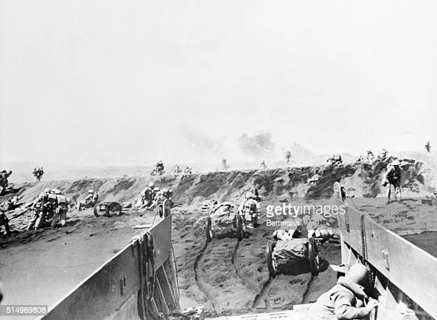 In the above pictures, Marines of the 4th Division storm ashore, taking cover on numerous craters left by our bombardment, as well as the trenches...