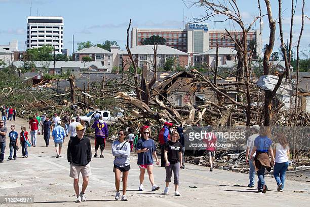 In the aftermath of a severe tornado, residents wander the steets near downtown Tuscaloosa surveying the damage on April 28, 2011 in Tuscaloosa,...