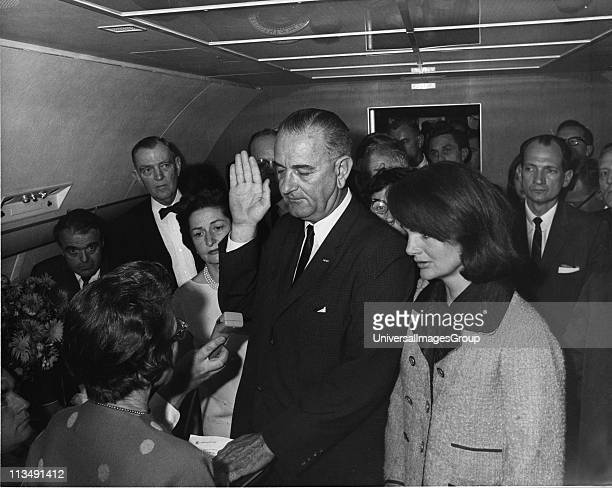 In the aftermath of the assasination of US President John F. Kennedy, American politician and Vice-President Lyndon Baines Johnson takes the oath of...