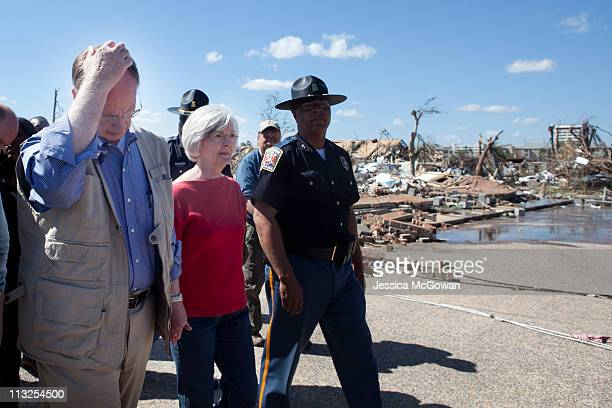 In the aftermath of Wednesday night's storms Alabama Gov Robert Bentley and his wife Dianne walk through a destroyed area near the University of...