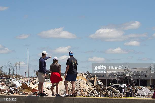 In the aftermath of Wednesday night's storms, University of Alabama students Neal Hooper, Meaghan Williams and Alex Brown look at the destroyed...