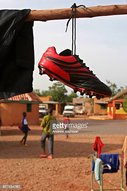 In the AMPO orphanage yard the football kit hangs out to dry ready for the Coaching for Hope tournament in Burkina Faso All the children��s football...
