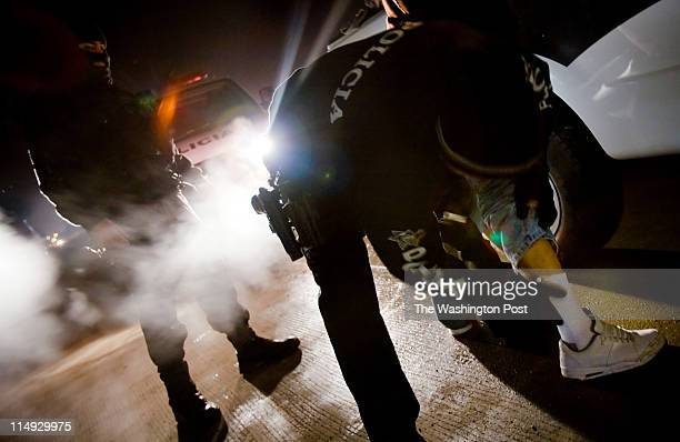 In the area of Mesa de Otay in Tijuana two municipal police officers who are members of a Special Operations group search a suspect The drug cartel...