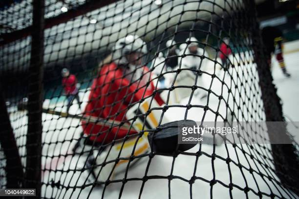 in the back of the net - puck stock pictures, royalty-free photos & images