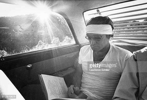 In the backseat of a car Irish actor Richard Harris makes notes for an upcoming plays as he leaves the set of the film 'A Man Called Horse' Mexico...