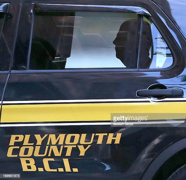 "In the backseat of a Plymouth County Sheriff vehicle, James ""Whitey"" Bulger arrives at the John Joseph Moakley United States Courthouse on June 5,..."