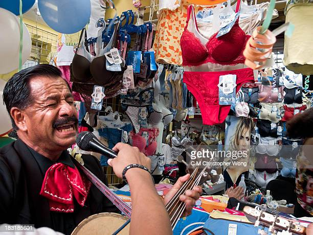 In the bazaar of Guayaquil, Colombia, a mariachi band was hired to celebrate the birthday of a lady who works in this lingerie store. The singer gave...