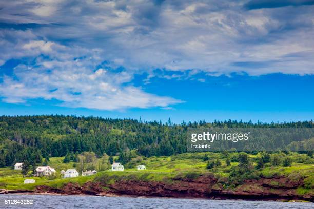 in the beautiful gaspésie region, saint lawrence river bonaventure island in percé, which is part of quebec's national park system. to the exception of a few buildings used by the government, nobody has lived on the island since 1971. - gaspe peninsula stock pictures, royalty-free photos & images