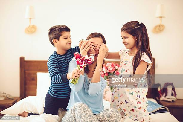 in the bedroom - mother's day stock pictures, royalty-free photos & images
