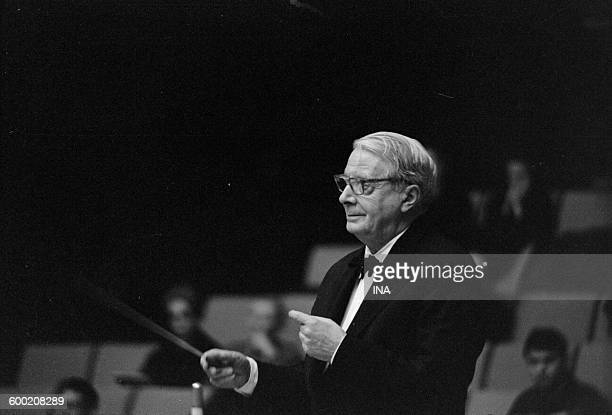 In the big auditorium 104 of the Maison de la Radio Charles Munch manages the National orchestra interpreting the symphony 'Pacem in Terris' of...