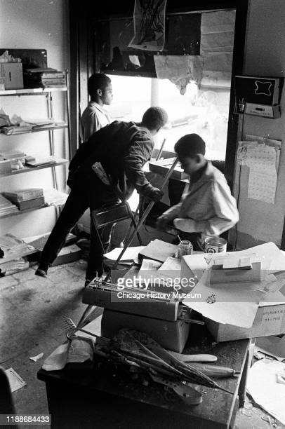 In the Black Panther Party's Illinois chapter headquarters , several people look out of the window as they clean up after a police raid, Chicago,...