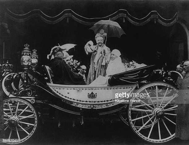 In the carriage of the Queen Mother Emma her daughter Queen Wilhelmina Prince Consort Heinrich and hidden Princess Juliana in the Netherlands