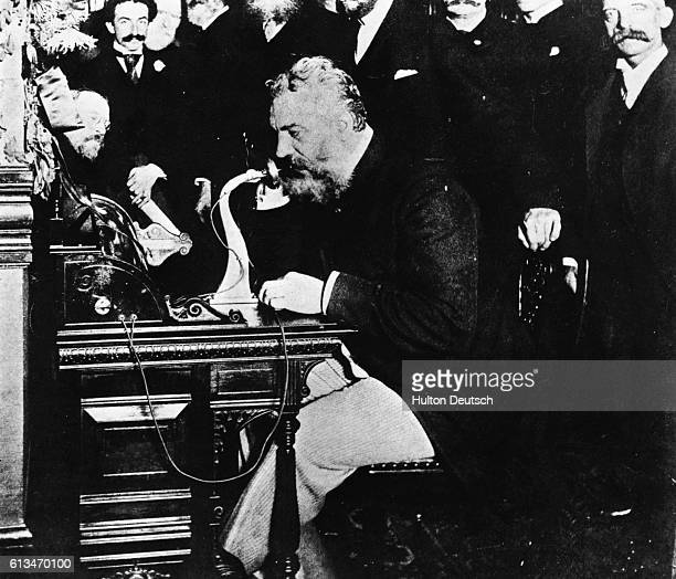 In the centennial year of 1876 Alexander Graham Bell sent his first telephone message Here he is 16 years later surrounded by executives making the...