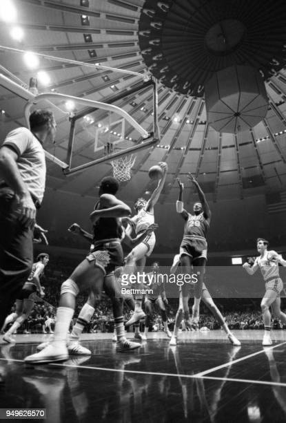 In the center of a semicircle of players Knicks' Phil Jackson and Phoenix's Paul Silas battle for a rebound during Madison Square Garden play. New...