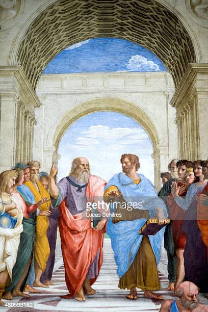 In the center of the fresco The School of Athens by Raphael Plato and Aristotle discuss in the Vatican Museums on August 4 in Rome Italy Vatican City...