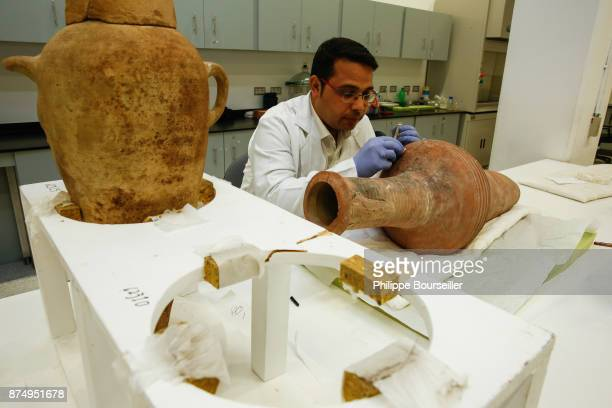 In the Ceramics conservation laboratory the preservative Ahmed Mostafa Aabdel Halim cleans two jars reserved for transporting liquids