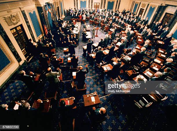 In the chamber of the United States Senate, Supreme Court Chief Justice William Rehnquist swears in the Senate members to participate in the...