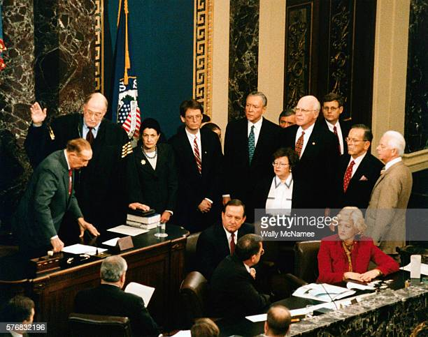 In the chamber of the United States Senate Supreme Court Chief Justice William Rehnquist is sworn in to oversee the impeachment trial of President...