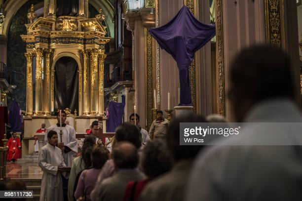 In the churches, the images of saints are covered on purple cloths as a sign of mourning, bread is distributed to remember the Last Supper and sprigs...