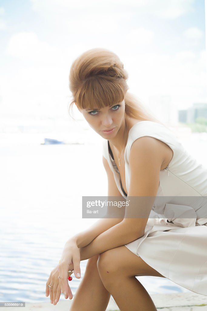 In the city. Girl on a sunny day : Stock Photo