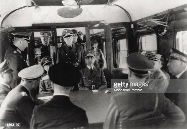 In the clearing of CompiFgne, on the same train wagon where the German surrender was signed in November, the negotiations for the armistice sign are...