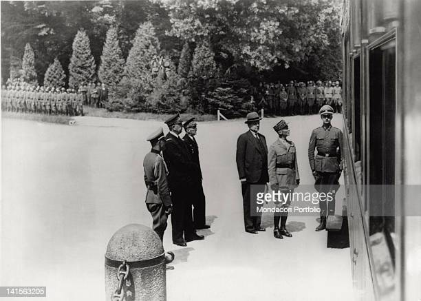 In the clearing of CompiFgne the French delegation composed of General Charles Hutzinger followed by the undersecretary of Foreign Affairs Leon Noel...