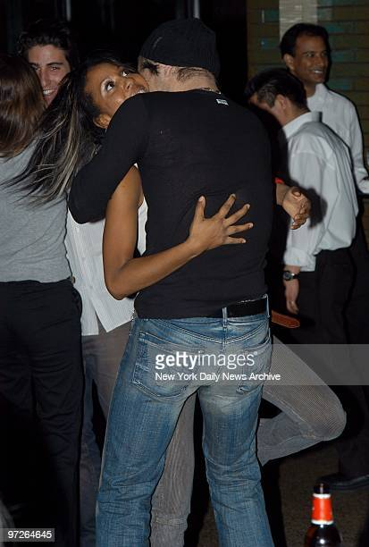 In the clutch it's dancing cheektocheek and then some for Colin Farrell and his partner Sade during a postscreening party at Park for his new movie...