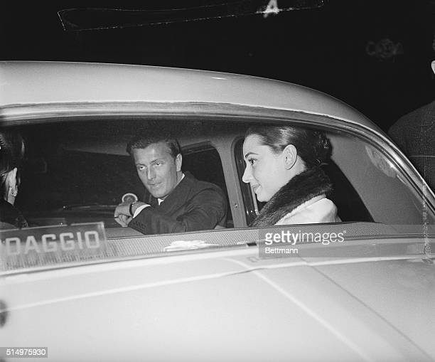 In the company of a friend of hers French fashion designer Hubert de Givenchy Hollywood actress Audrey Hepburn is seen through the window of a car as...