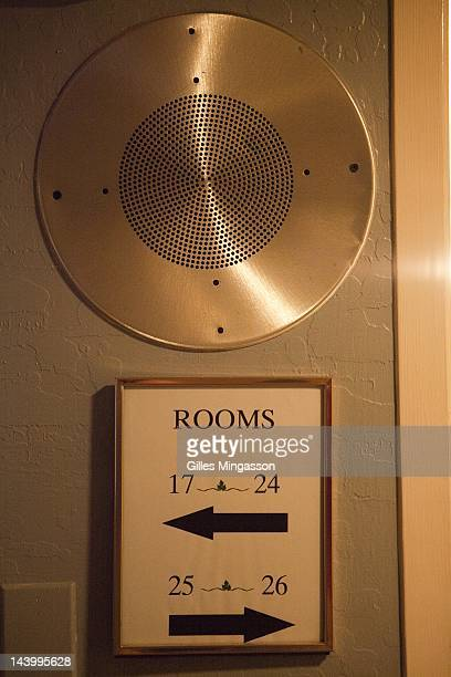 In the corridors leading to prostitutes rooms loud speakers signal the arrival of new clients and summons the prostitutes to a line up where they are...