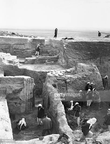 In the cradle of civilization between the Tigris and Euphrates Rivers British Archeologist ME Mallowan supervises the excavation of ancient Assyrian...