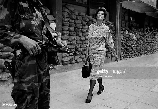 In the dangerous suburb of Dobrinja Meliha Varesanovic walks proudly and defiantly to work during the Siege of Sarajevo 1995 Her message to the...