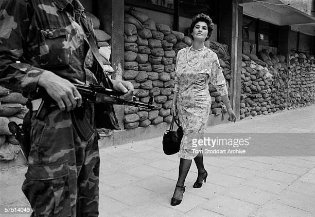 In the dangerous suburb of Dobrinja Meliha Vareshanovic walks proudly and defiantly to work during the siege of Sarajevo Her message to the watching...